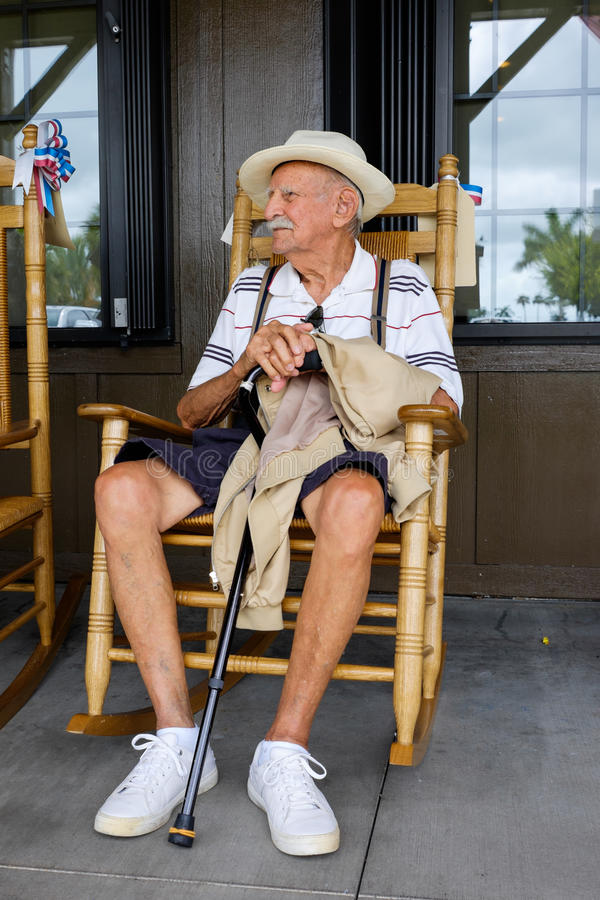 Elderly man. Elderly eighty plus year old man sitting on a rocking chair stock images