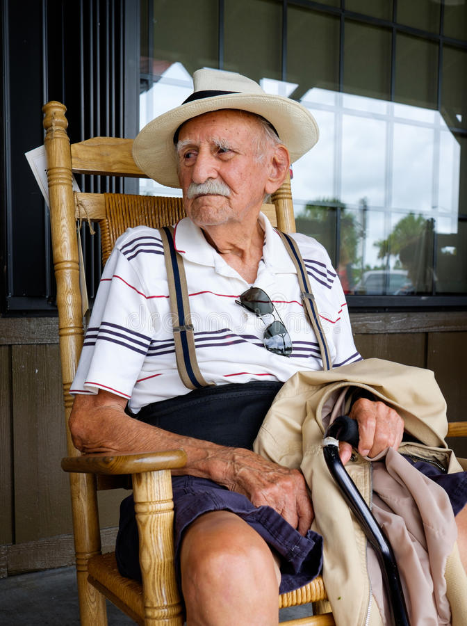 Elderly man. Elderly eighty plus year old man sitting on a rocking chair royalty free stock images