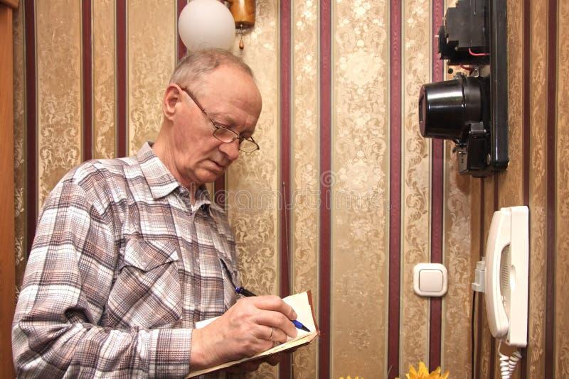 Download An Elderly Man Electric Meter Stock Image - Image: 13680059