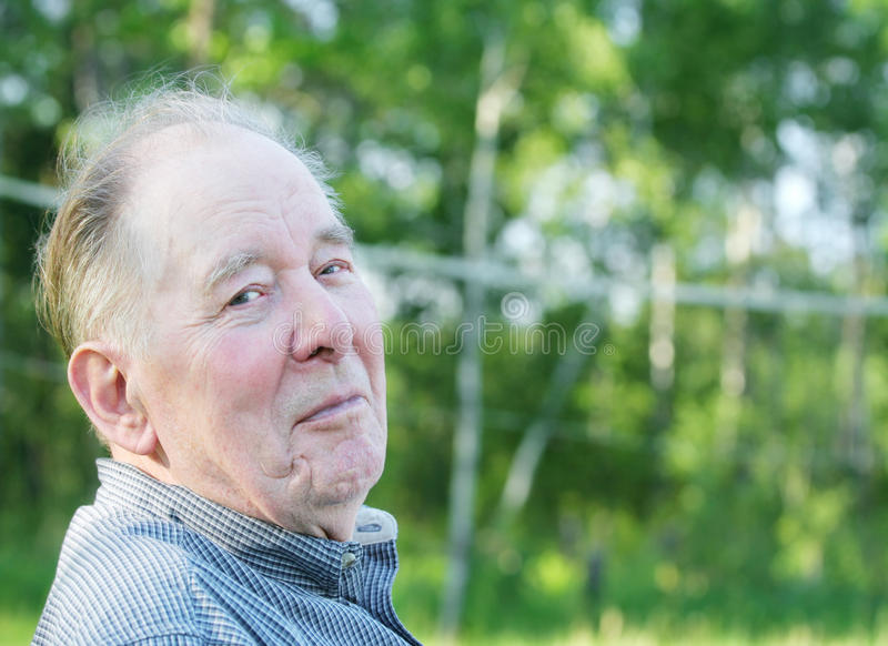Elderly man enjoying outdoors stock image