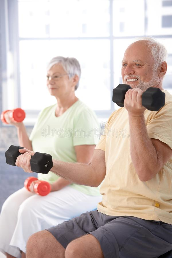 Download Elderly Man Exercising With Dumbbells Stock Image - Image: 20855433