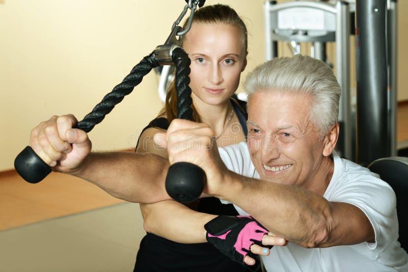 Elderly man exercising stock photo