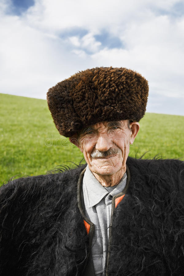Elderly man in felt cloak royalty free stock photography