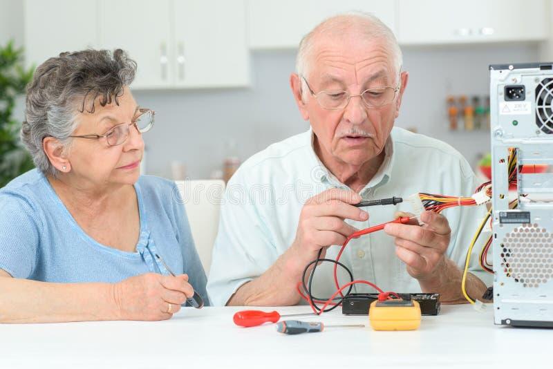 Elderly man fixing cpu royalty free stock image