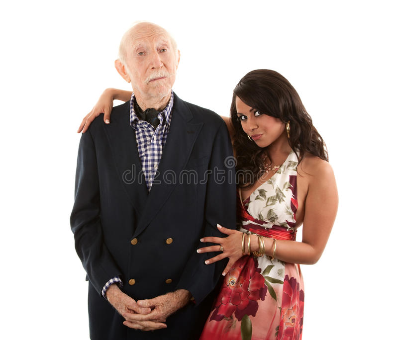 Elderly man with gold-digger companion or wife stock image