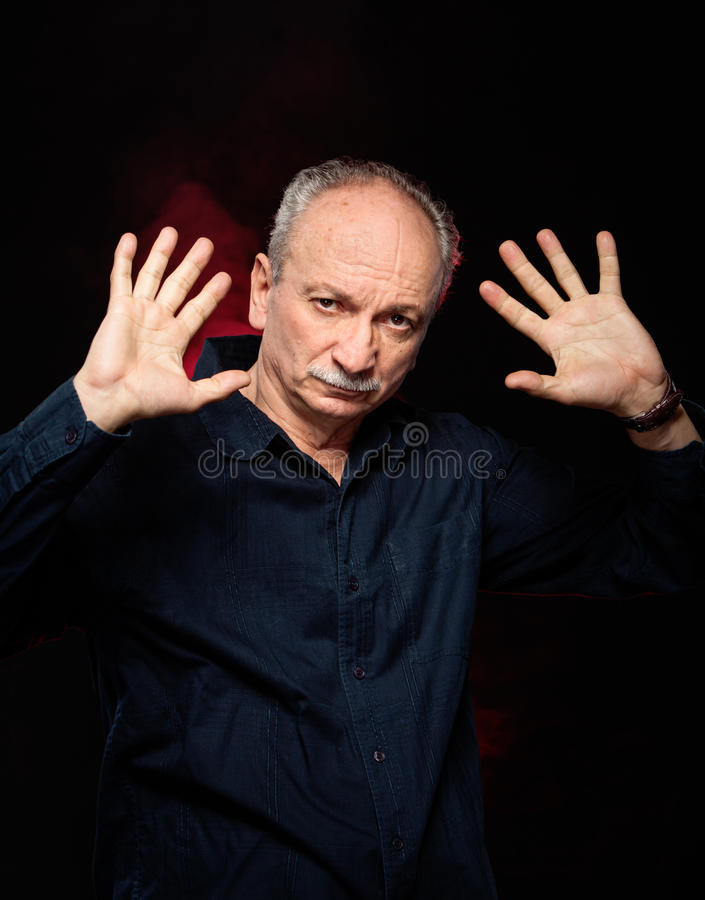 Download Elderly man with hands up stock photo. Image of executive - 27714354