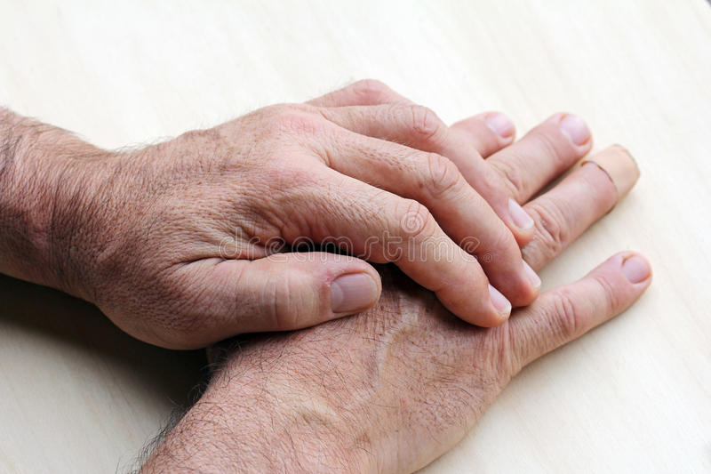 Elderly man has pain in his hands royalty free stock image