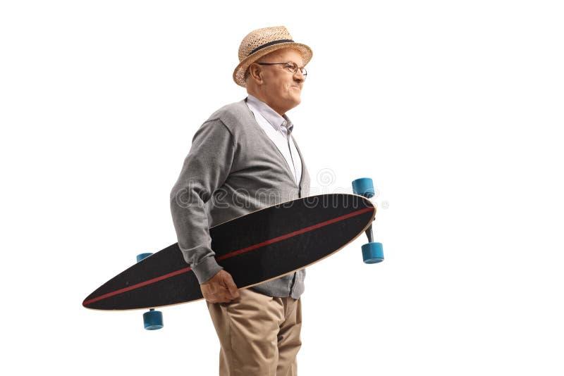 Elderly man holding a longboard royalty free stock photos