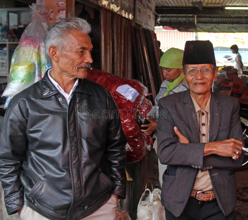 ELDERLY MAN IN INDONESIA. Two elderly man in a wet market in the city of Padang in West Sumatra, Indonesia royalty free stock photography