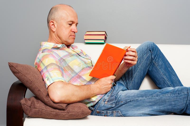 Elderly man with interesting book stock photo