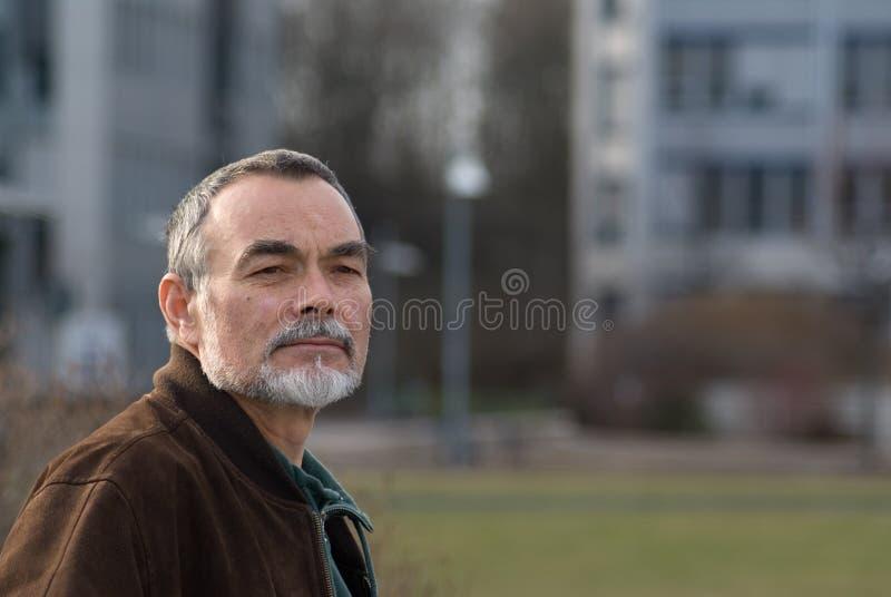 Elderly man in jacket royalty free stock image