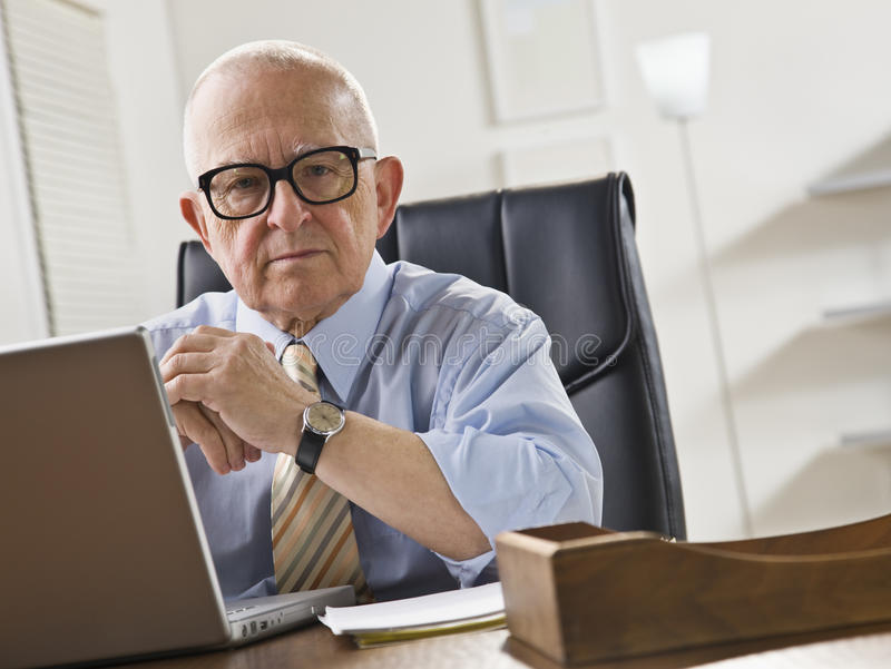 Elderly Man on Laptop stock image