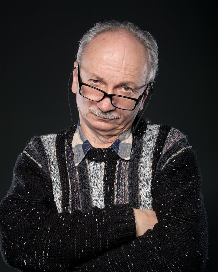 Elderly man looks skeptical