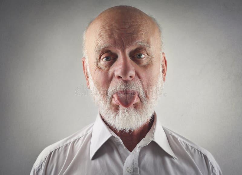 Elderly man making jokes. Elderly man making funny jokes royalty free stock image
