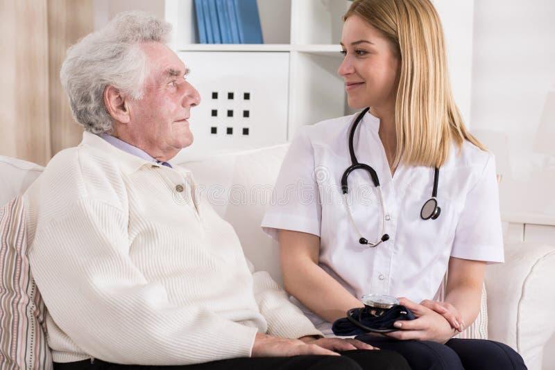 Elderly man during medical visit. Picture of rich elderly men during private medical visit stock image