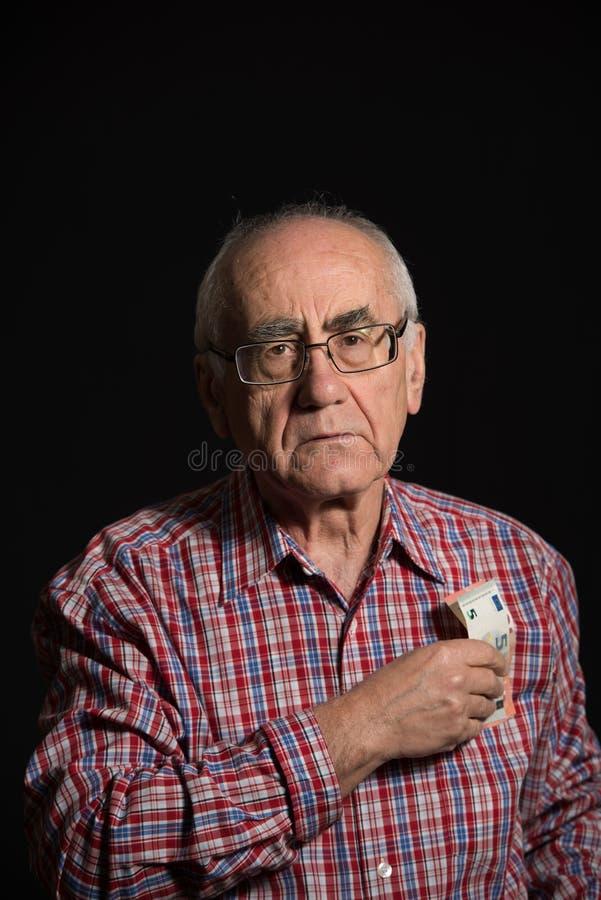Elderly man with money stock photos