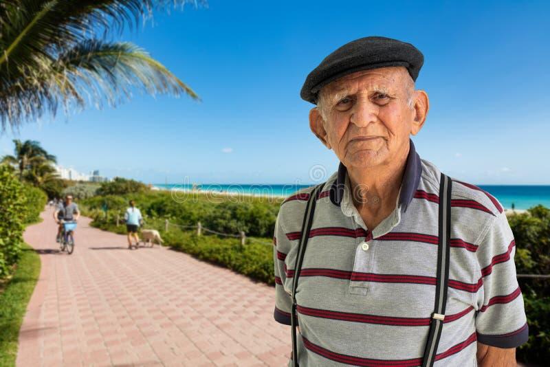 Elderly Man Outdoors. Elderly 80 plus year old man outdoor portrait enjoying Miami Beach stock images