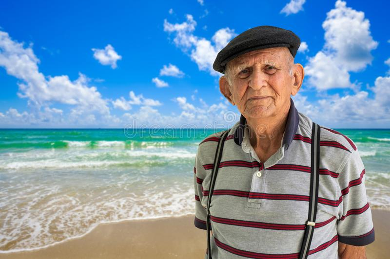 Elderly Man Outdoors. Elderly 80 plus year old man outdoor portrait with a beach background royalty free stock photography
