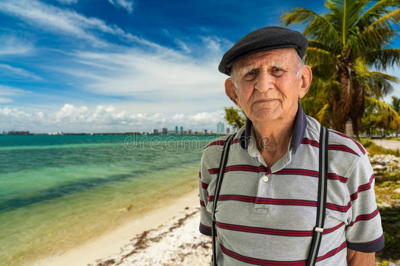 Elderly Man Outdoors. Elderly 80 plus year old man outdoor portrait with a beach background stock photos