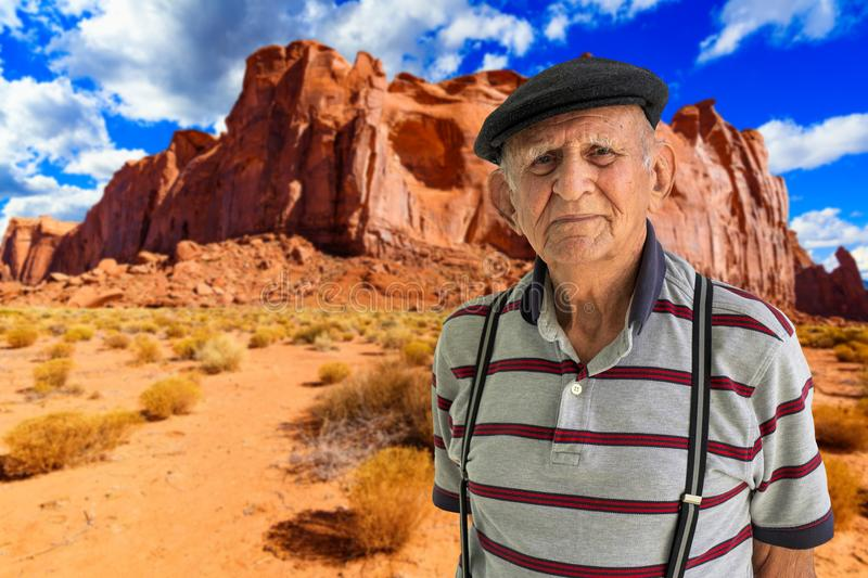 Elderly Man Outdoors. Elderly 80 plus year old man outdoor portrait with a beautiful Utah desert background royalty free stock photo