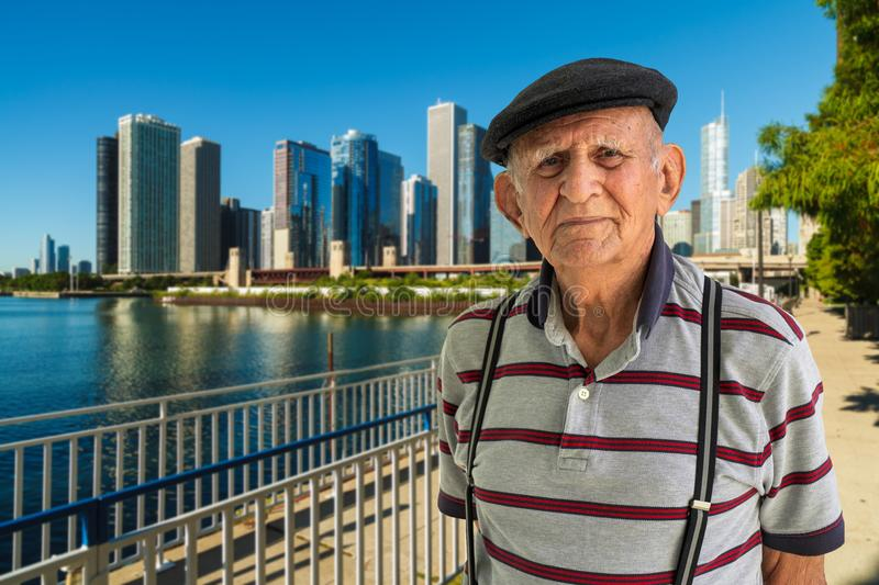 Elderly Man Outdoors. Elderly 80 plus year old man outdoor portrait with the Chicago skyline in the background royalty free stock photography