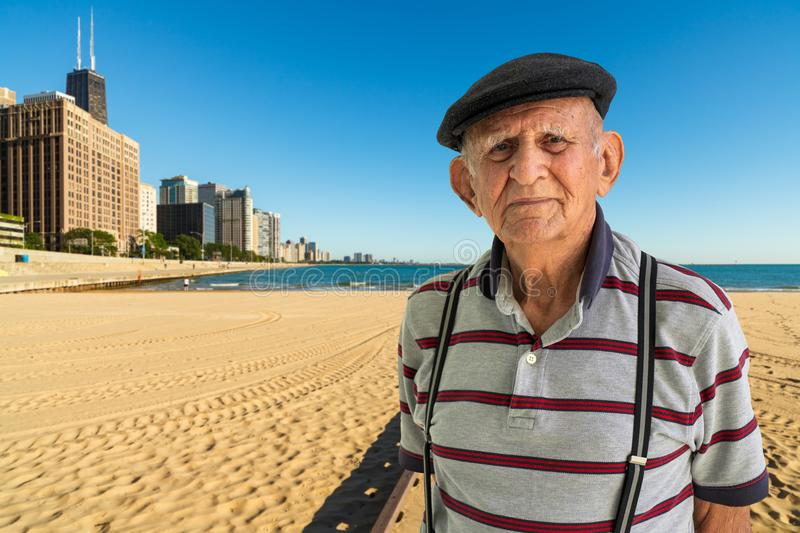 Elderly Man Outdoors. Elderly 80 plus year old man outdoor portrait with the Chicago skyline and Lake Michigan in the background royalty free stock image