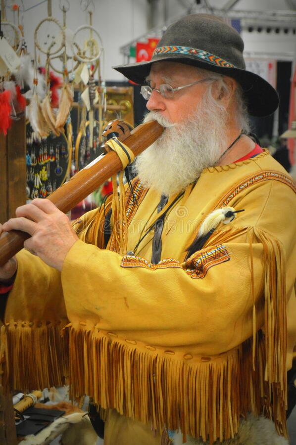 Free Elderly Man Playing A Wooden Flute Pipe Stock Photos - 172932903