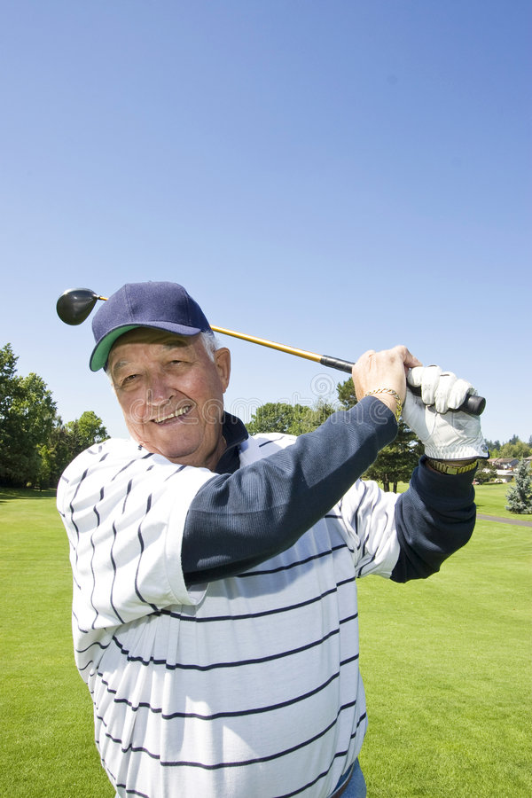 Elderly man Playing Golf stock images