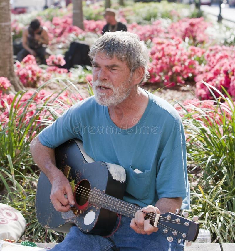 Free Elderly Man Playing Guitar Royalty Free Stock Photo - 23892415