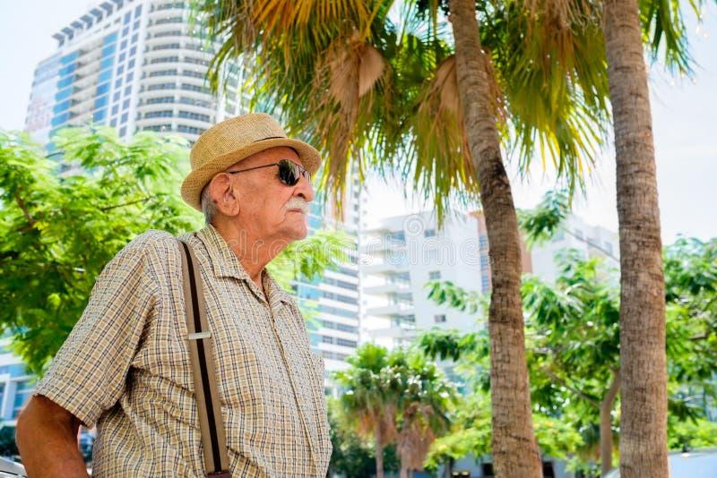 Elderly man. Elderly 80 plus year old man in a outdoor setting stock photo