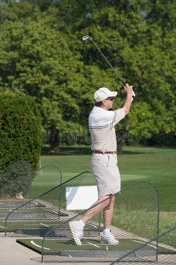 Elderly Man Practicing Golf stock image