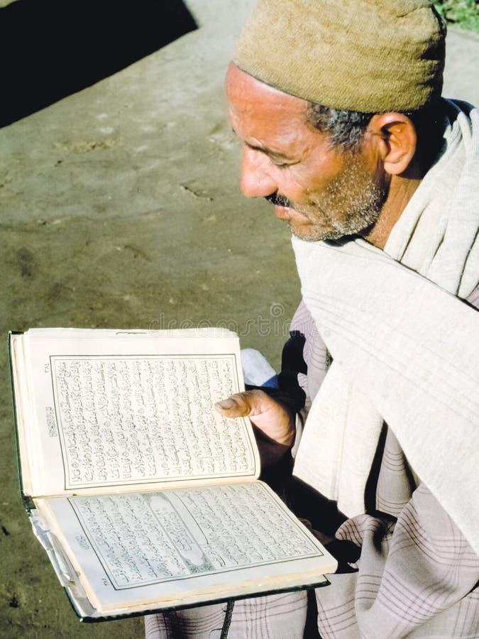 An elderly man reads the Koran. Egyptian Muslim royalty free stock photography