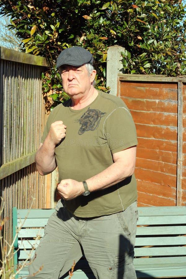 Elderly man-ready to fight. stock image