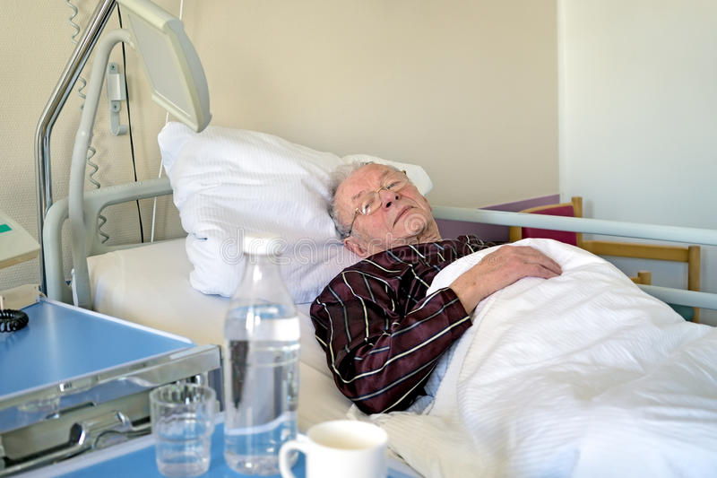 Elderly man recuperating in a hospital stock photo