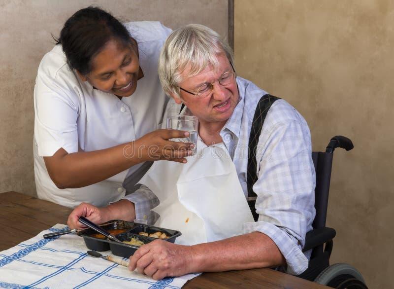 Elderly man refusing to drink water royalty free stock photo