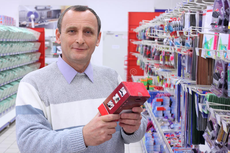 Elderly man in shop with box royalty free stock photography