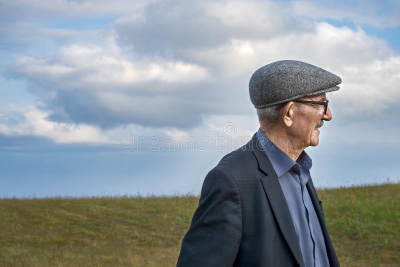Elderly man sideview royalty free stock photo