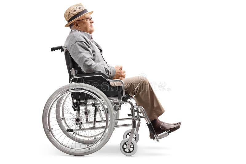 Elderly man sitting in a wheelchair. Full length profile shot of an elderly man sitting in a wheelchair isolated on white background stock photos