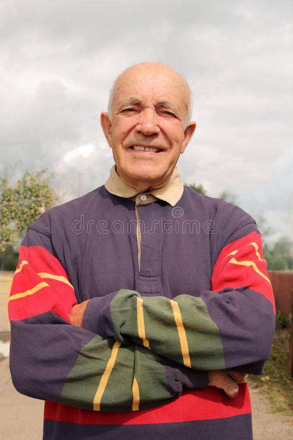 An elderly man smiling in the sun royalty free stock photography