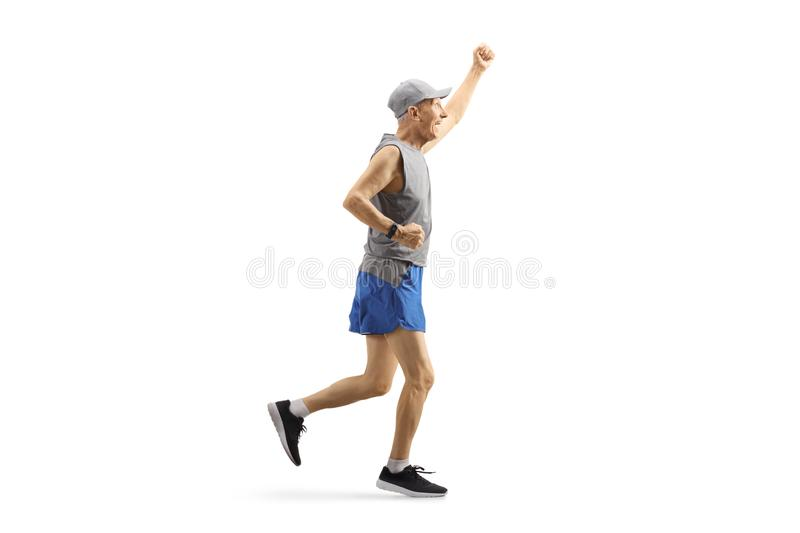 Elderly man in sportswear running and gesturing happiness stock image
