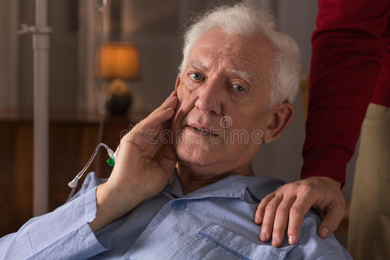 Elderly man suffering from dementia. Portrait of sad elderly men suffering from dementia royalty free stock image