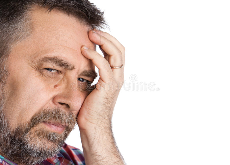 Elderly man. Suffering from a headache. Isolated on white with copy-space stock image
