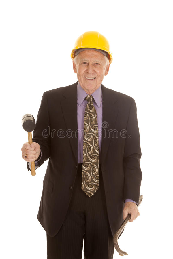 Elderly man suit hardhat tools smile stock photos
