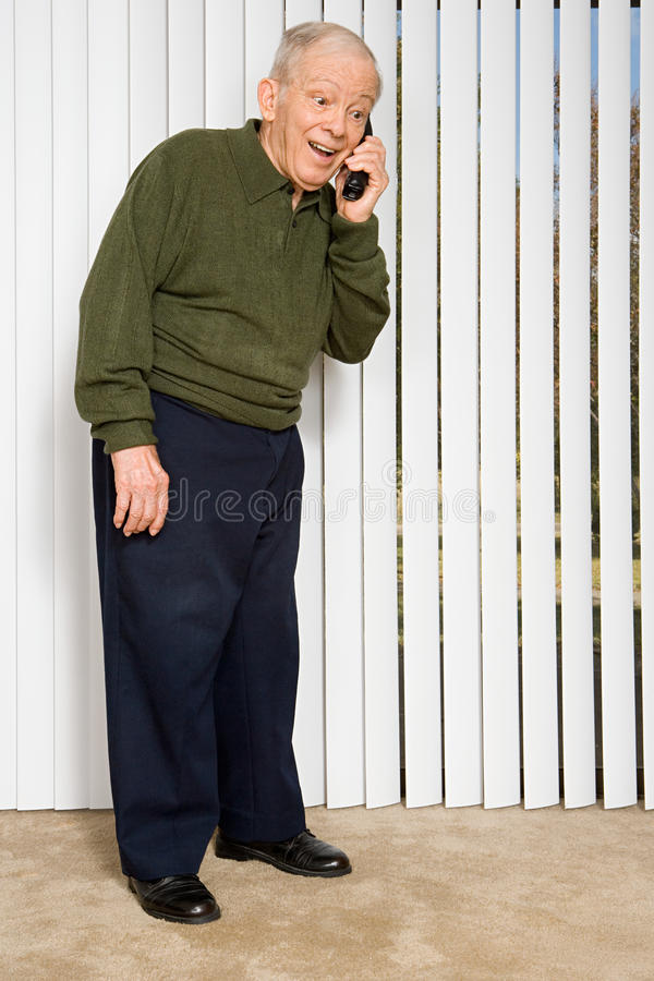 Elderly man on the telephone stock images