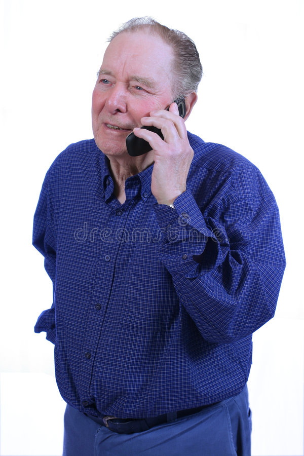 Elderly man using cell phone. Talking on cell phne stock photography