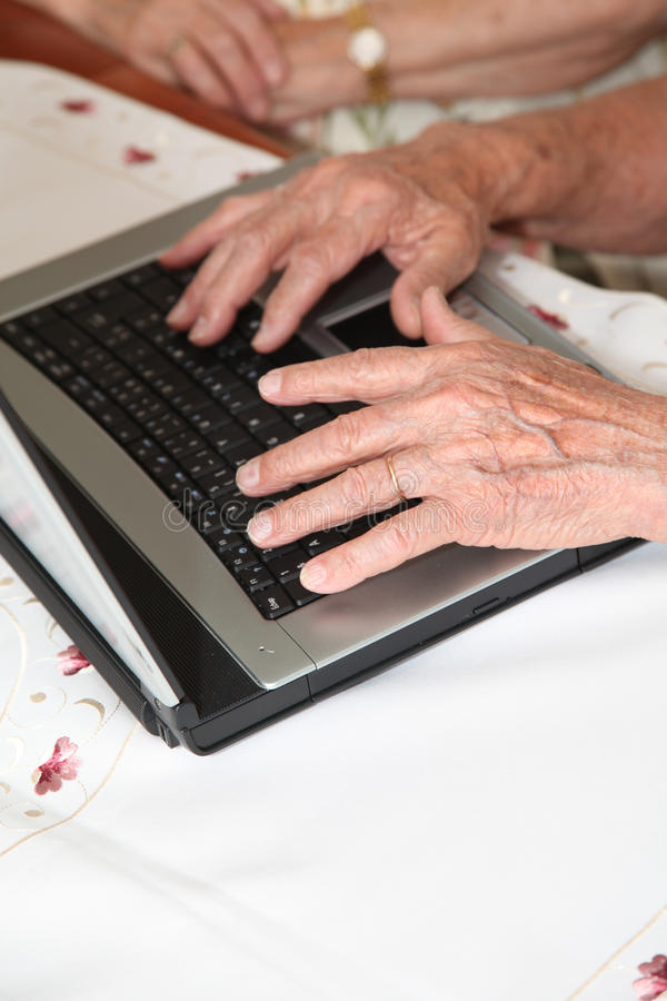 Elderly man using computer royalty free stock photos