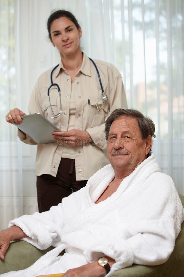 Elderly man waiting for examination royalty free stock photography
