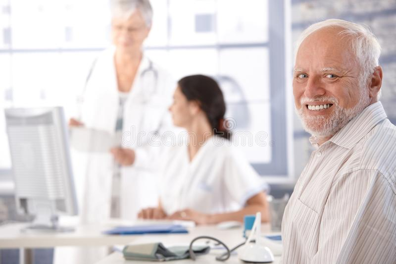 Download Elderly Man Waiting For Examination Smiling Stock Image - Image: 21535181