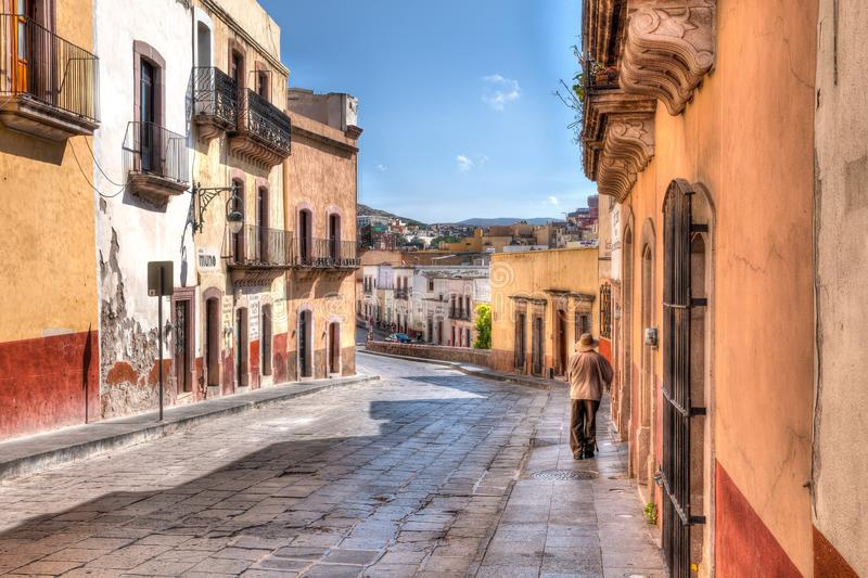 Streets of Zacatecas Mexico. Elderly Man walking on a Sunday Morning in Zacatecas Mexico stock photo