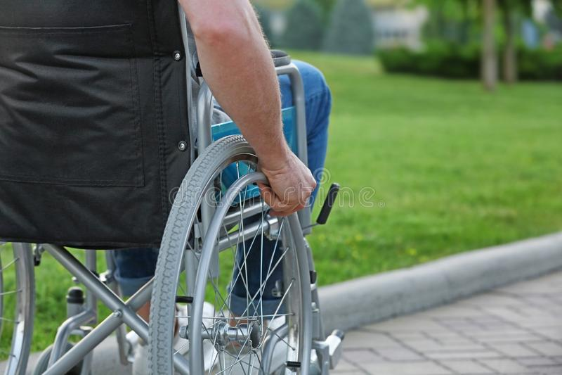 Elderly man in wheelchair. Outdoors stock images